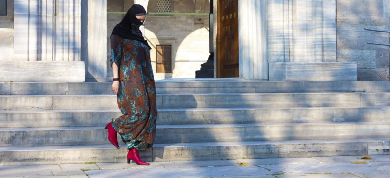 Muslim woman wearing red boots